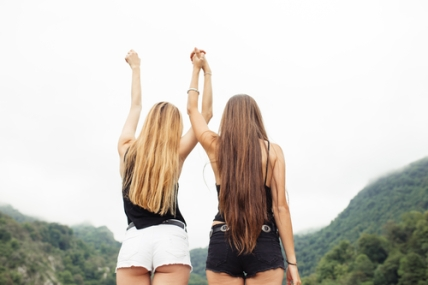 Back of two girls together in nature